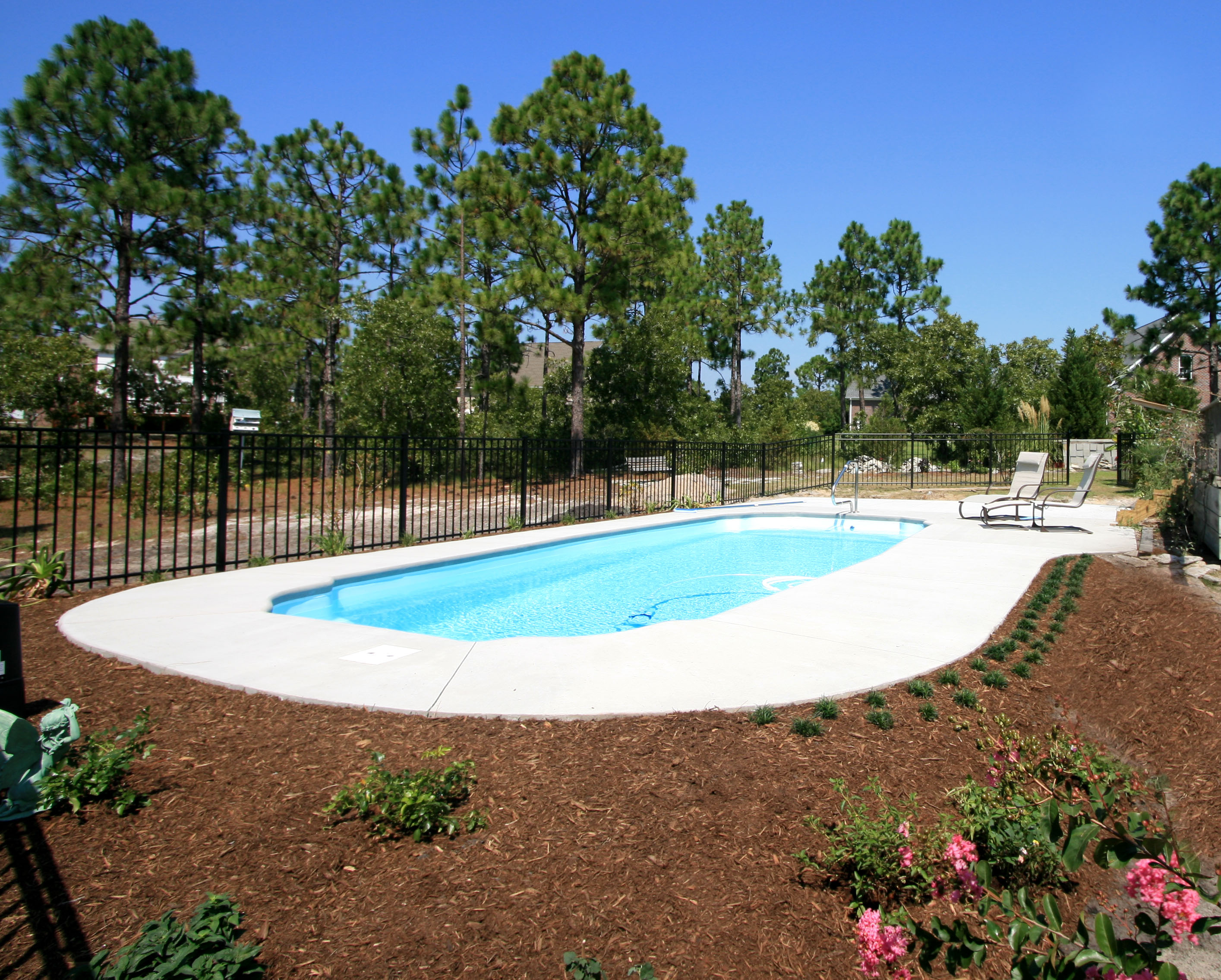 By Raising The Pool A Little To Meet Grade On Upslope Of Yard And Building Sloping Berm Opposite Side Retaining Wall Will Become